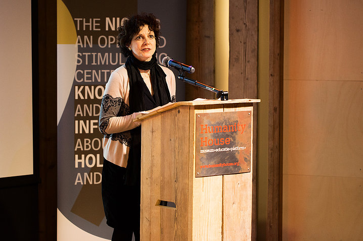 Dr. Nanci Adler speaking at the Centennial Project Foundation in 2014 at The Hague